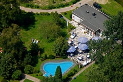 Aerial picture of the club house with sun terrace and paddling pool